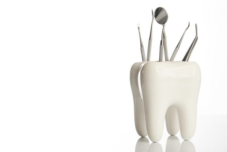Dental tools in a giant tooth model