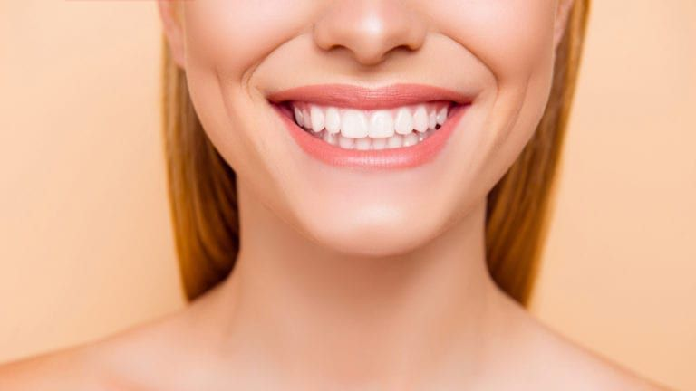 Woman smiling with a flawless smile